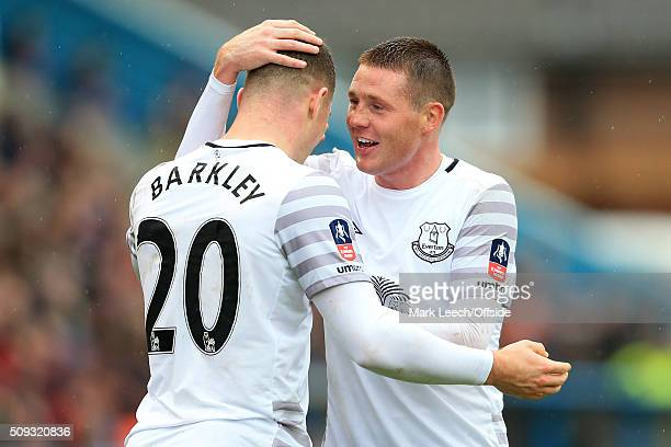 James McCarthy of Everton congratulates teammate Ross Barkley after he scored their 3rd goal during the Emirates FA Cup Fourth Round match between...