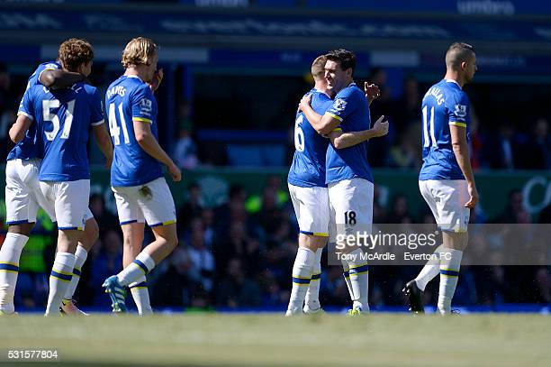 James McCarthy of Everton is congratulated by Gareth Barry after scoring his goal during the Barclays Premier League match between Everton and...