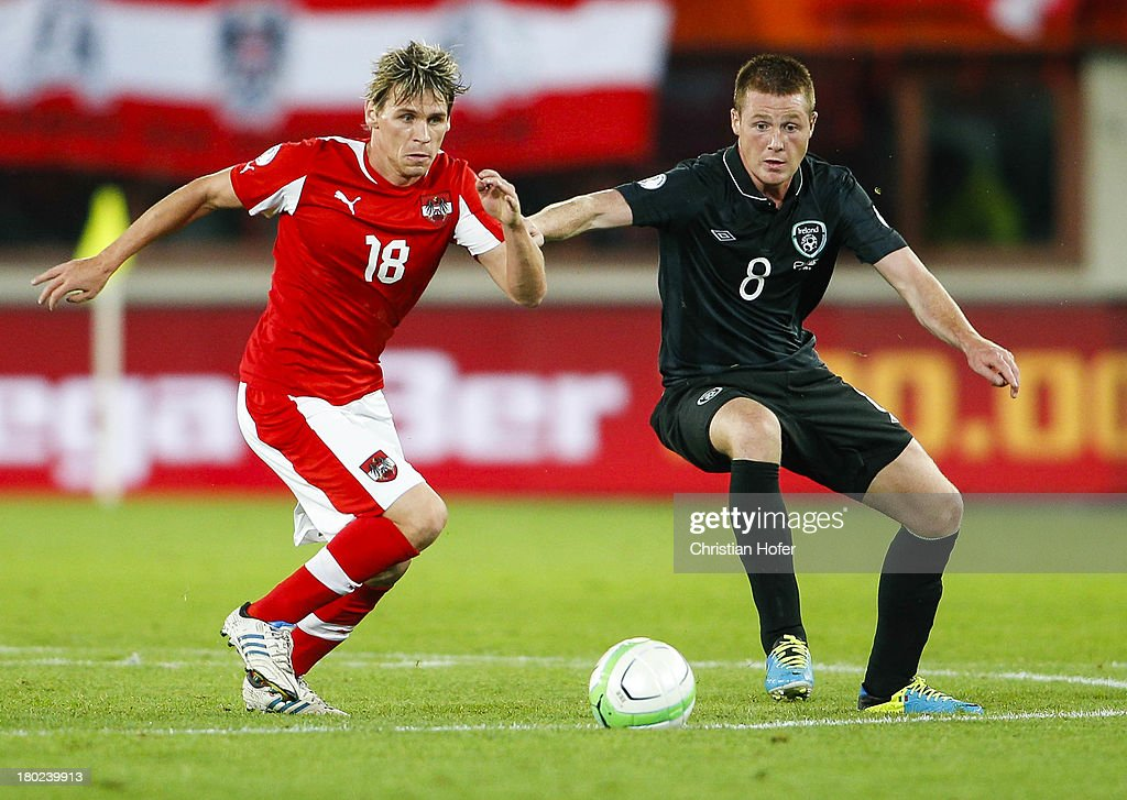 James McCarthy of Ireland (R) challenges Christoph Leitgeb of Austria during the FIFA World Cup 2014 Group C qualification match between Austria and the Republic of Ireland at the Ernst Happel Stadium on September 10, 2013 in Vienna, Austria.