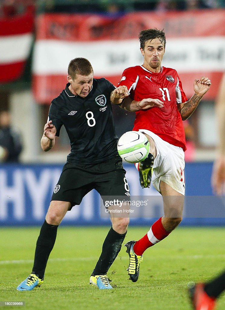 James McCarthy of Ireland (L) challenges Martin Harnik of Austria during the FIFA World Cup 2014 Group C qualification match between Austria and the Republic of Ireland at the Ernst Happel Stadium on September 10, 2013 in Vienna, Austria.