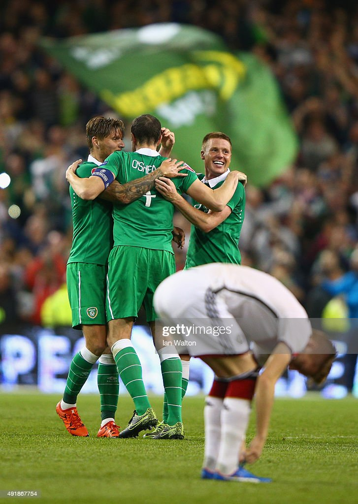James McCarthy of Republic of Ireland (L) celebrates victory with John O'Shea of Republic of Ireland (C) after the UEFA EURO 2016 Qualifier group D match between Republic of Ireland and Germany at the Aviva Stadium on October 8, 2015 in Dublin, Ireland.