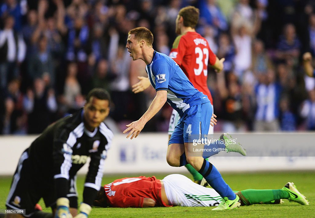 James McCarthy of Wigan Athletic (4) celebrates as he scores their second goal during the Barclays Premier League match between Wigan Athletic and Swansea City at DW Stadium on May 7, 2013 in Wigan, England.
