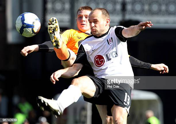 James McCarthy of Wigan Athletic challenges Danny Murphy of Fulham during the Barclays Premier League match between Fulham and Wigan Athletic at...