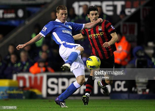 James McCarthy of Wigan Athletic competes with Gareth Barry of Manchester City during the Barclays Premier League match between Wigan Athletic and...