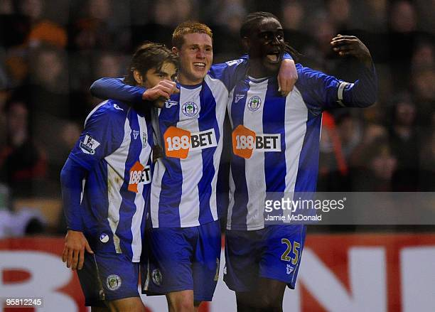 James McCarthy of Wigan celebrates his goal with Mario Melchiot and Mohamed Diame during the Barclays Premier League match between Wolverhampton...