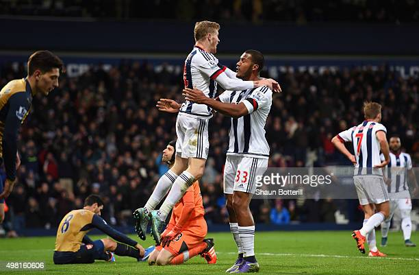 James McClean and Salomon Rondon of West Bromwich Albion celebrate after Mikel Arteta of Arsenal scores an own goal during the Barclays Premier...