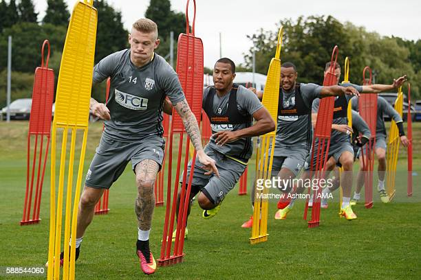 James McClean and Salomon Rondon of West Bromwich Albion during a training session at West Bromwich Albion Training Ground on August 11 2016 in...
