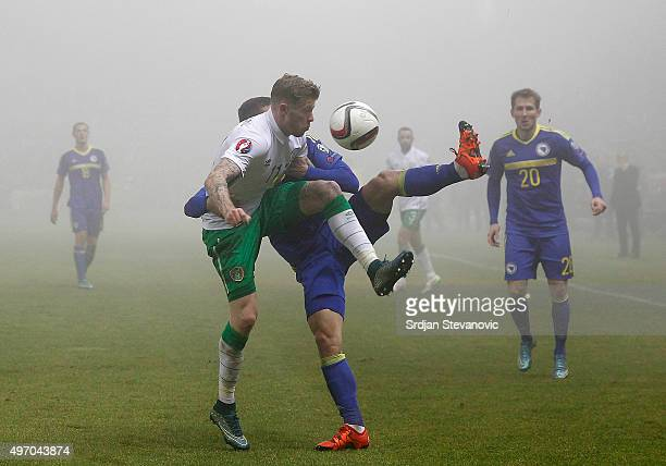 HERZEGOVINA NOVEMBER 13 James McClean of Ireland competes for the ball against Ognjen Vranjes of Bosnia during the EURO 2016 Qualifier PlayOff First...