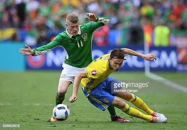 James McClean of Republic of Ireland and Albin Ekdal of Sweden compete for the ball during the UEFA EURO 2016 Group E match between Republic of...
