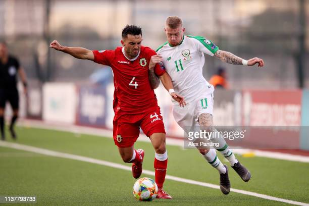 James McClean of Republic of Ireland and Jack Sergeant of Gibraltar battle for the ball during the 2020 UEFA European Championships group D...
