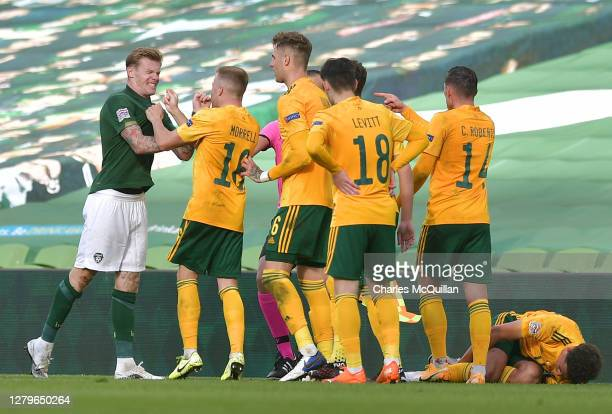 James McClean of Republic of Ireland argues with players from Wales before being shown the red card during the UEFA Nations League group stage match...