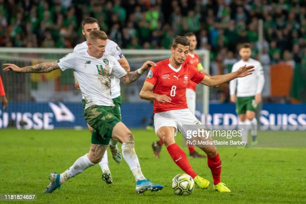 James McClean of Republic of Ireland battles for the ball with Remo Freuler of Switzerland during the UEFA Euro 2020 qualifier between Switzerland...