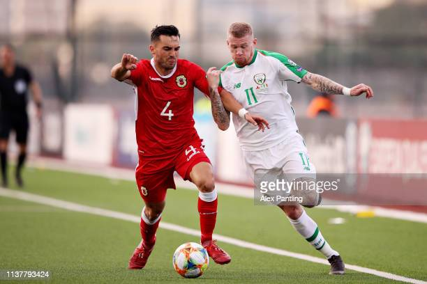 James McClean of Republic of Ireland is challenged by Jack Sergeant of Gibraltar during the 2020 UEFA European Championships group D qualifying match...