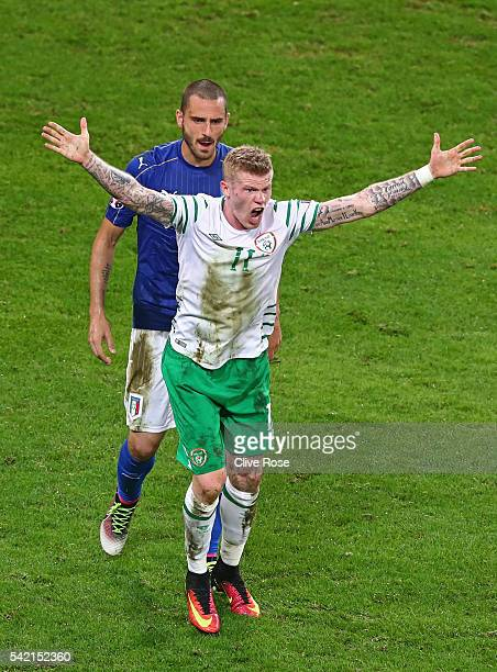 James McClean of Republic of Ireland protest against the decision after a challenge by Federico Bernardeschi of Italy during the UEFA EURO 2016 Group...