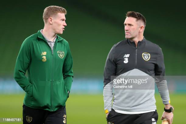 James McClean of Republic of Ireland speaks with Assistant Manager of Republic of Ireland Robbie Keane as they inspect the pitch ahead of the UEFA...