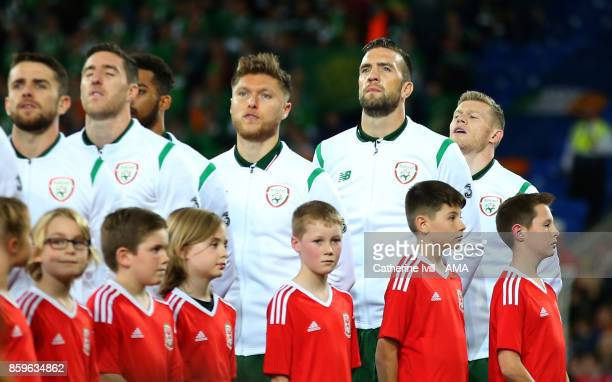 James McClean of Republic of Ireland stands at the back during the national anthem before the FIFA 2018 World Cup Qualifier between Wales and...