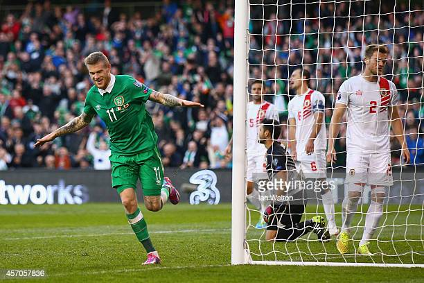 James McClean of Republic of Ireland turns to celebrate after scoring a goal during the EURO 2016 Qualifier match between Republic of Ireland and...