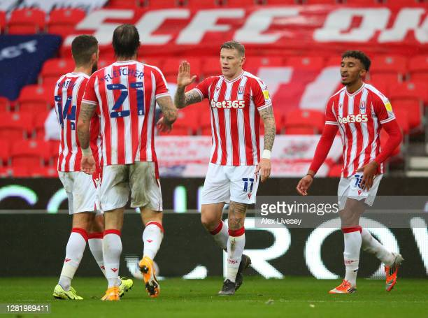 James McClean of Stoke City celebrates with teammates after scoring his team's second goal during the Sky Bet Championship match between Stoke City...