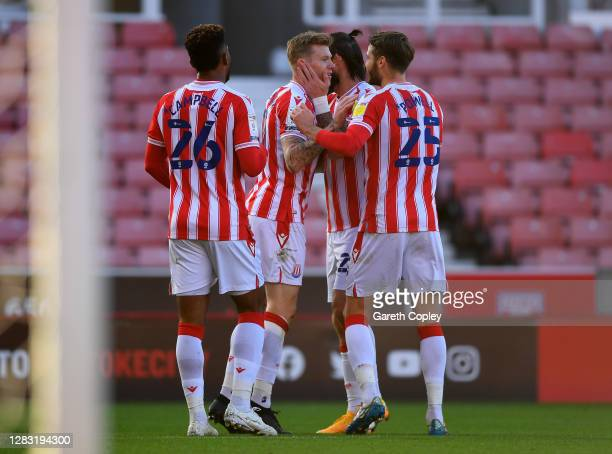 James McClean of Stoke City celebrates with teammates after scoring his team's first goal during the Sky Bet Championship match between Stoke City...
