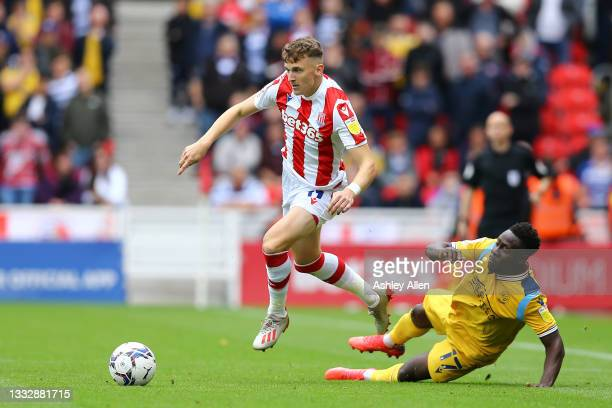 James McClean of Stoke City is challenged by Andy Yiadom of Reading FC during the Sky Bet Championship match between Stoke City and Reading at Bet365...
