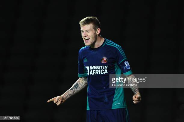 James McClean of Sunderland celebrates scoring their second goal during the Captial One Cup third round match between MK Dons and Sunderland at the...