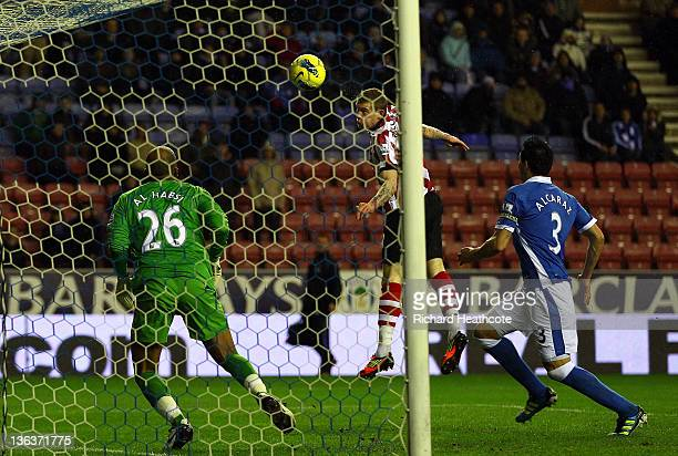 James McClean of Sunderland scores the second goal during the Barclays Premier League match between Wigan Athletic and Sunderland at the DW Stadium...
