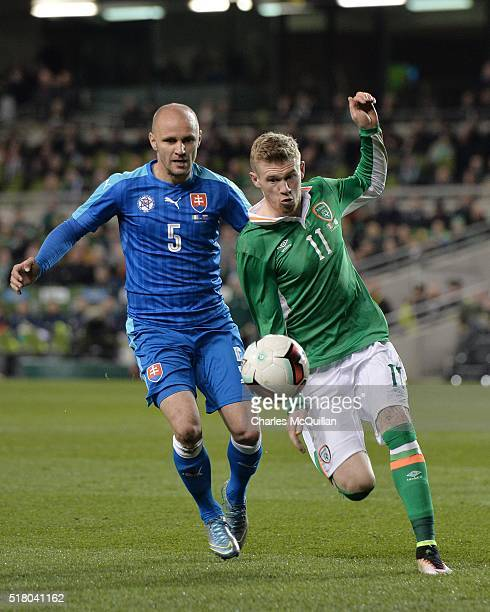 James McClean of the Republic of Ireland and Lukas Tesak of Slovakia during the international friendly match between the Republic of Ireland and...