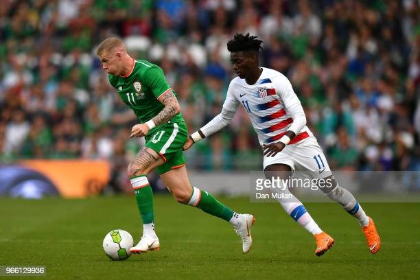 James McClean of the Republic of Ireland breaks away from Tim Weah of The United States during the International Friendly match between the Republic...