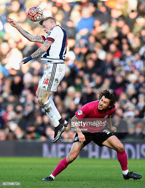 James McClean of West Bromwich Albion and Lawrie Wilson of Peterborough United compete for the ball during The Emirates FA Cup Fourth Round match...