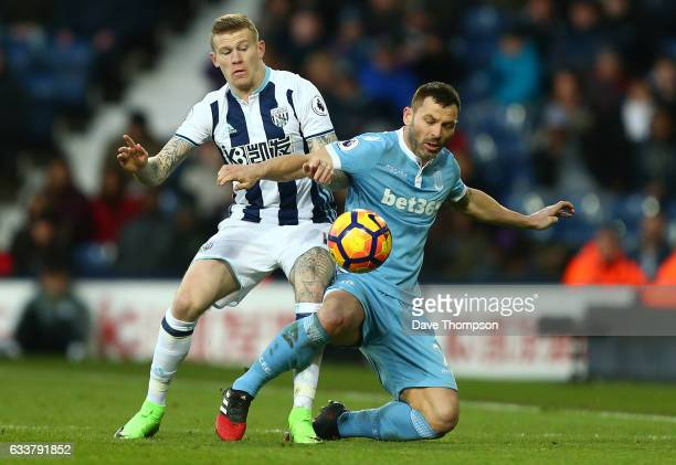 James McClean of West Bromwich Albion and Phil Bardsley of Stoke City compete for the ball during the Premier League match between West Bromwich...