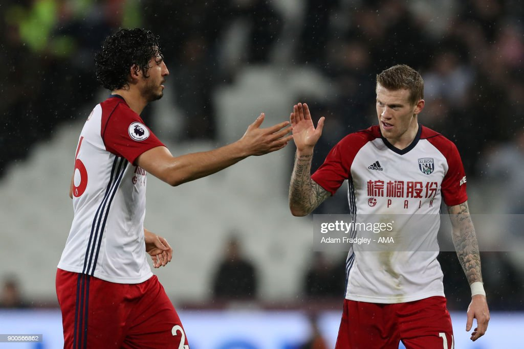 James McClean of West Bromwich Albion celebrates after scoring a goal to make it 0-1 with Ahmed Hegazi of West Bromwich Albion during the Premier League match between West Ham United and West Bromwich Albion at London Stadium on January 2, 2018 in London, England.
