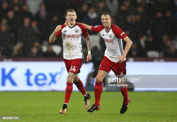 James McClean of West Bromwich Albion celebrates after scoring his sides first goal Jonny Evans of West Bromwich Albion during the Premier League...