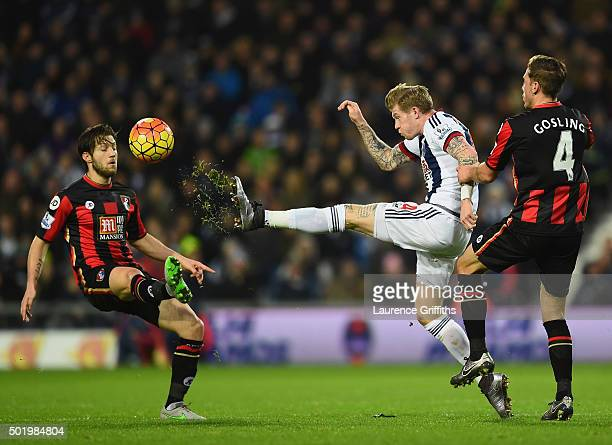 James McClean of West Bromwich Albion competes for the ball against Harry Arter and Dan Gosling of Bournemouth during the Barclays Premier League...