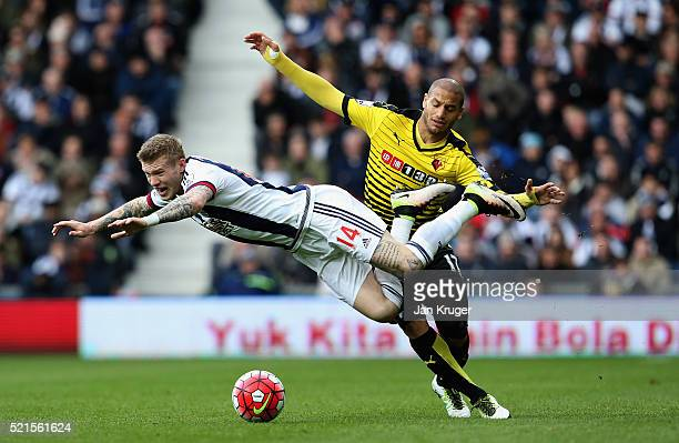 James McClean of West Bromwich Albion is challenged by Adlene Guedioura of Watford during the Barclays Premier League match between West Bromwich...