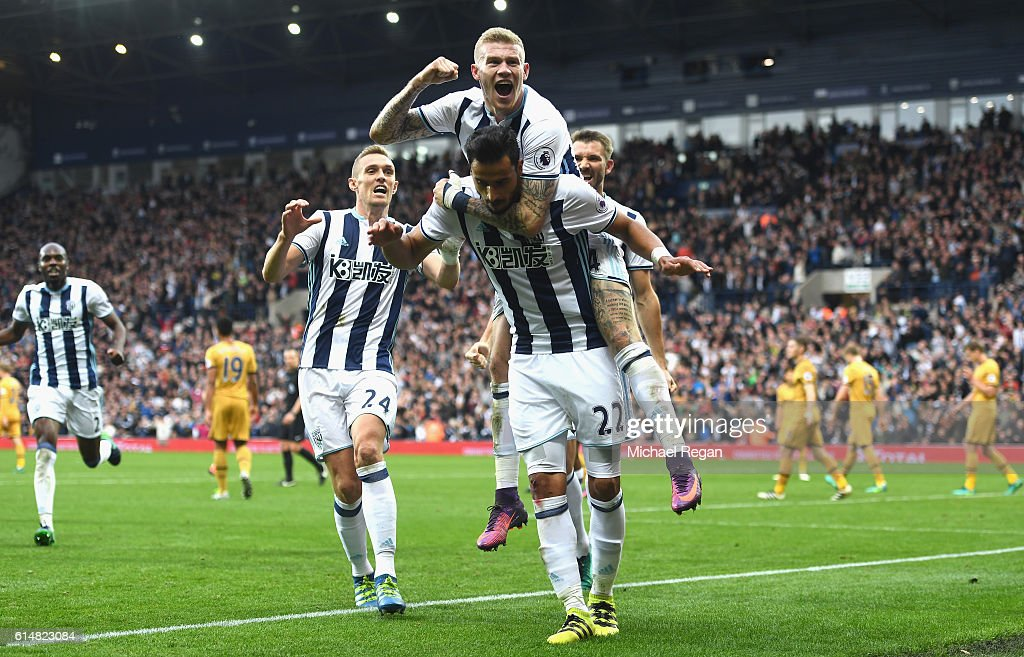 James McClean of West Bromwich Albion (C) jumps on Nacer Chadli of West Bromwich Albion (C) as he celebrates scoring his sides first goal during the Premier League match between West Bromwich Albion and Tottenham Hotspur at The Hawthorns on October 15, 2016 in West Bromwich, England.