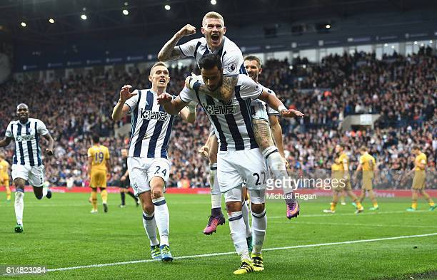 James McClean of West Bromwich Albion jumps on Nacer Chadli of West Bromwich Albion as he celebrates scoring his sides first goal during the Premier...