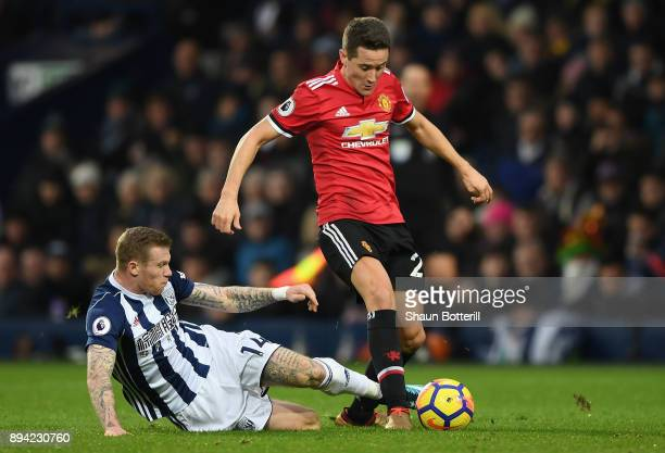 James McClean of West Bromwich Albion tackles Ander Herrera of Manchester United during the Premier League match between West Bromwich Albion and...