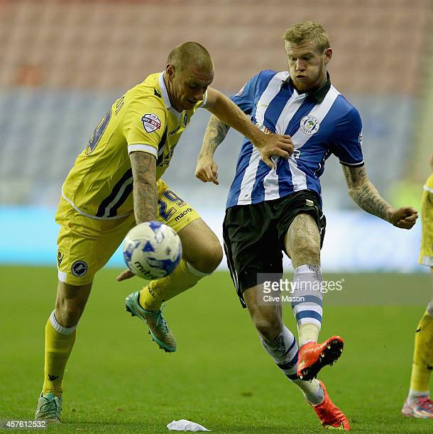 James McClean of Wigan is tackled by Andy Wilkinson of Millwall during the Sky Bet Championship match between Wigan Athletic and Millwall at DW...