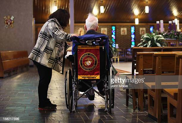 James McCormick is comforted by a neighbor at the St Charles Catholic Church before a funeral for his longtime partner David Maxwell who died in...