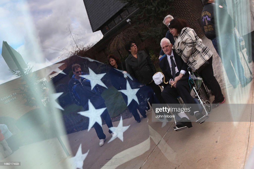 James McCormick, 72, is reflected in a window as he is brought out from the St. Charles Catholic Church after a funeral for his longtime partner David Maxwell, 66, who died during Hurricane Sandy in the Midland Beach area of Staten Island on December 11, 2012 in New York City. Maxwell was the last of Sandy's victims found on Staten Island, when his body was discovered in his home 11 days after the storm. A Vietnam veteran, he was buried at the Calverton National Cemetery on Long Island, accompanied by honor guards from the Catholic War Veterans and the Patriot Guard Riders.