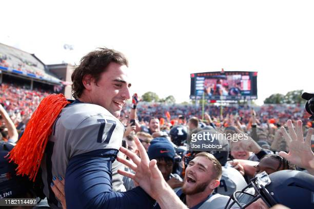 James McCourt of the Illinois Fighting Illini is lifted up after a 39-yard field goal against the Wisconsin Badgers as time expires in the game at...