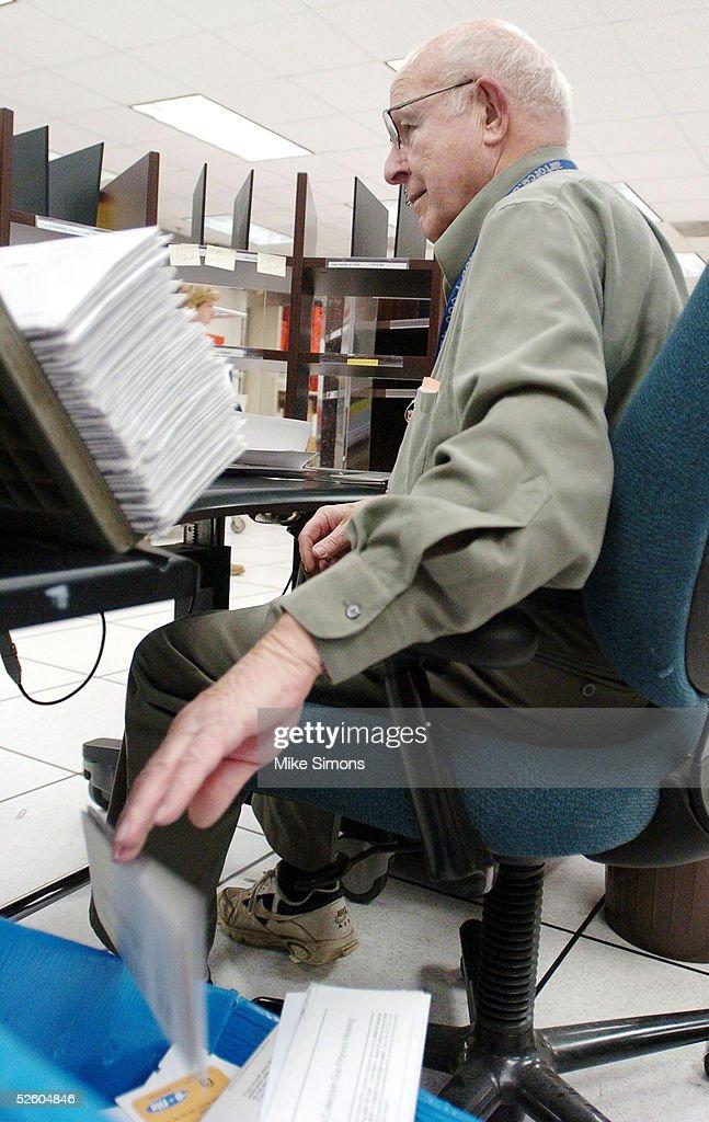 James McCullough sorts tax returns at the Cincinnati Internal Revenue Service Center April 8, 2005 in Covington, Kentucky. The tax filing deadline is a week away.