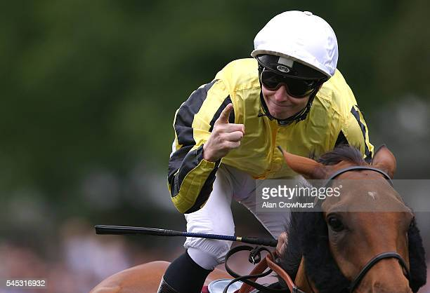 James McDonald celebrates victory after riding Big Orange to win The Princess Of Wales's Arqana Racing Club Stakes at Newmarket Racecourse on July 7...