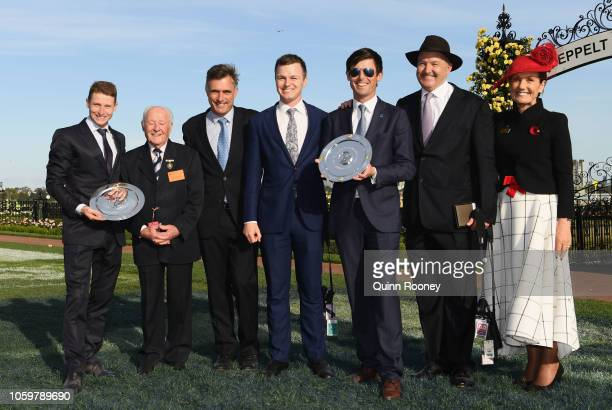 James McDonald poses with legend jockey Ron Hutchinson after being awarded the best jockey of the carnival whilst Cotrainers Tom Dabernig Ben Hayes...