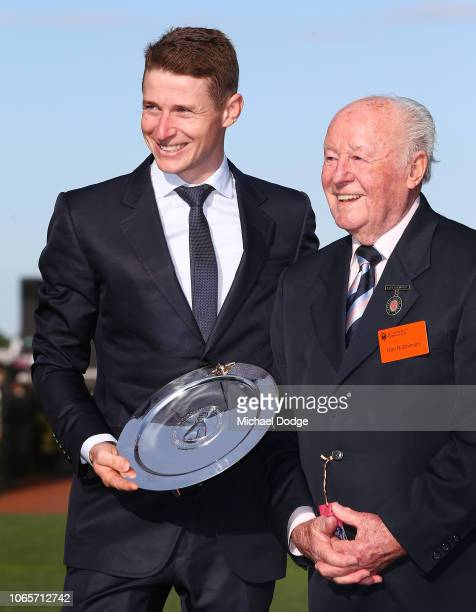 James McDonald poses with legend jockey Ron Hutchinson after being awarded the best jockey of the carnival during Stakes Day at Flemington Racecourse...