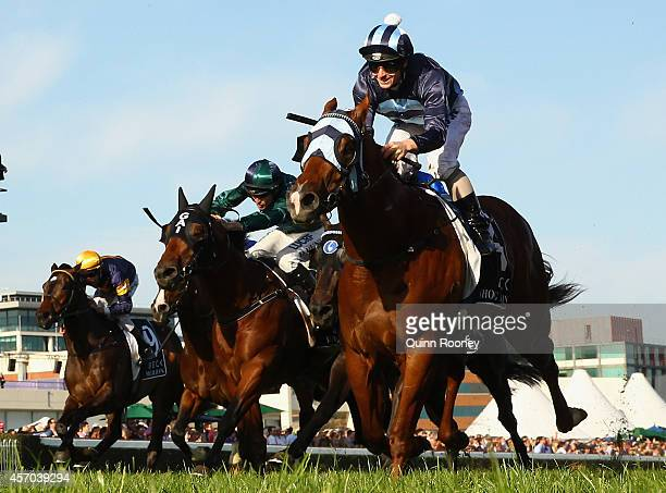 James McDonald riding Shooting to Win crosses the line to win the Caulfield Guineas during Caulfield Guineas Day at Caulfield Racecourse on October...
