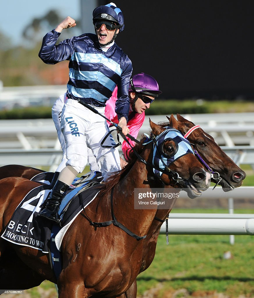James McDonald riding Shooting to Win reacts after defeating Michael Rodd riding Rich Enuff in Race 9,the Beck Caulfield Guineas during Caulfield Guineas Day at Caulfield Racecourse on October 11, 2014 in Melbourne, Australia.