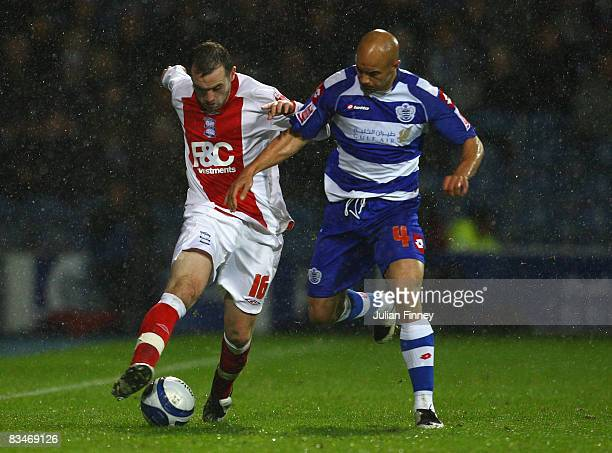 James McFadden of Birmingham battles with Gavin Mahon of QPR during the CocaCola Championship match between Queens Park Rangers and Birmingham City...
