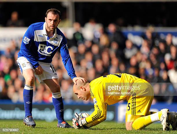 James McFadden of Birmingham City and Pepe Reina of Liverpool