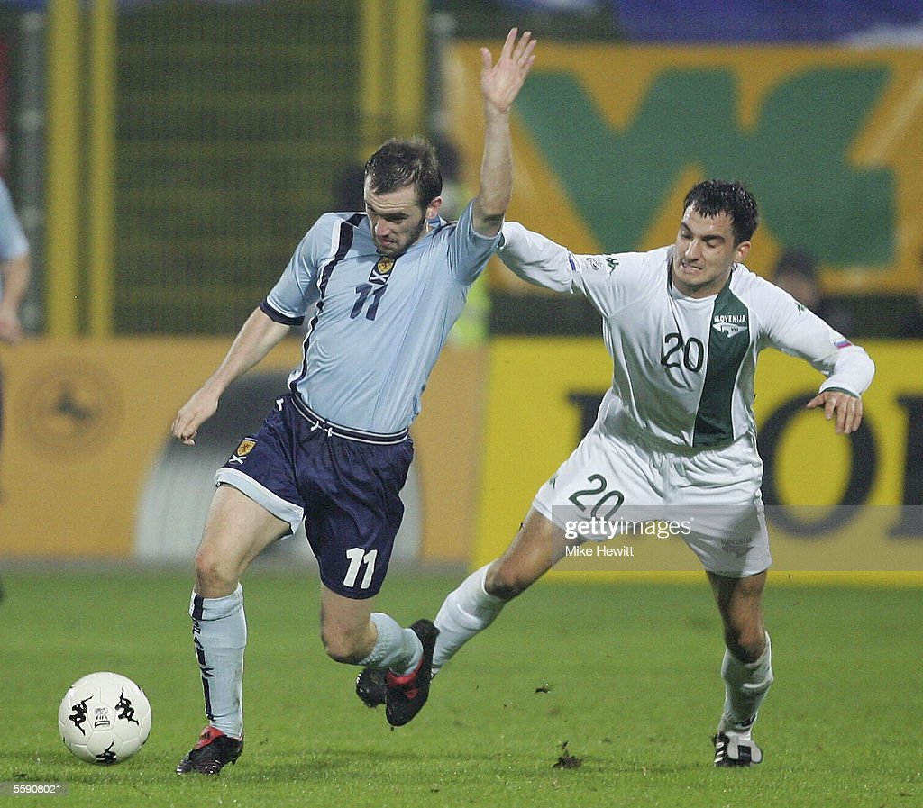 James McFadden of Scotland is pulled back by Branko Ilic of Slovenia during the FIFA World Cup group 5 qualifying match between Slovenia and Scotland on October 12, 2005 at the Petrol Arena Stadium in Celje, Slovenia.